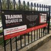 Training Boards UK - PVC Banner on fence in Tenby